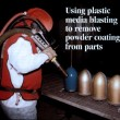 Powder coating is blasted off with plastic blast media.