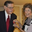 "Carol Diamond, Ted Diamond's wife of 69 years, pins ""Legion of Honor Medal"" to Ted's jacket."