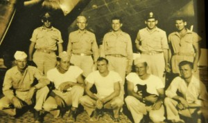 Ted Diamond (top row, second from right) pictured with members of WWII crew in front of bomber.